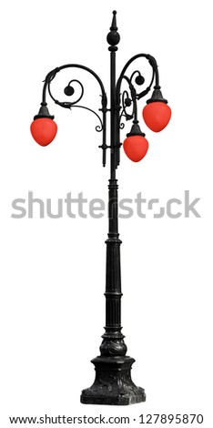 Vintage cast iron lamppost with red light isolated on white background - stock photo