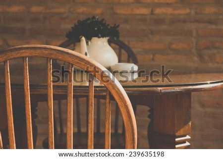 vintage chair and table with flower  - stock photo