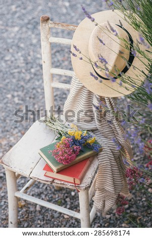 Vintage chair, books, hat and lavender - stock photo