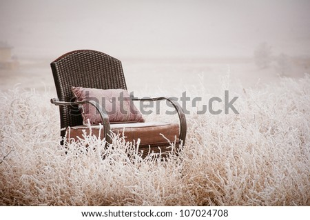 Vintage chair on a morning frost after a night of snow - stock photo