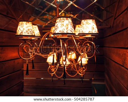 Vintage chandelier with light bulbs. Incandescent, retro design.