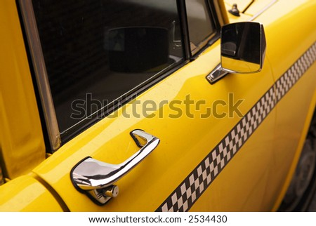 vintage checkered taxicab - stock photo