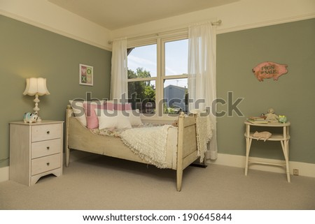 Vintage children bedroom / kids room with olive green walls, carpet and view window  - stock photo