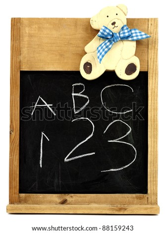 Vintage children's blackboard with a cute teddy bear - stock photo