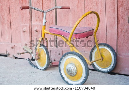 Vintage children tricycle - stock photo