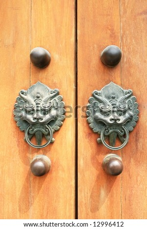 vintage Chinese door with knockers - stock photo