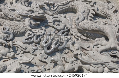 Vintage Chinese stone head dragon statue - stock photo