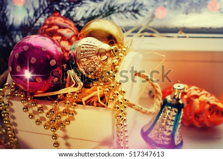 Vintage Christmas background with Christmas decoration against winter window.