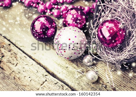 Vintage Christmas background with snow and Christmas decoration/christmas decorations on old wooden background - stock photo