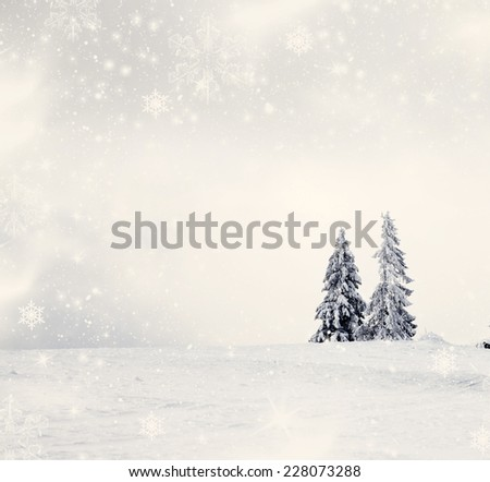 Vintage Christmas background with snowy fir trees and copy space - stock photo