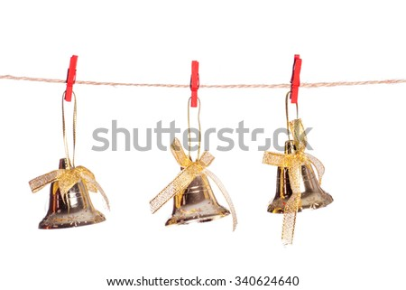 Vintage Christmas bells hanging on string isolated on white background