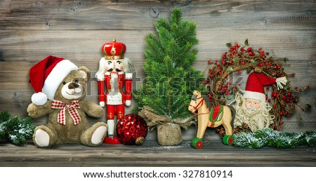 Vintage Christmas decoration Teddy Bear, Rocking Horse and Nutcracker. Retro style colored photo with vignette - stock photo