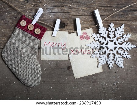 Vintage Christmas decorations and cards hanging on clotheslines  - stock photo