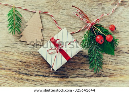 Vintage Christmas decorations and winter berries hanging on a braid, stylized photo - stock photo