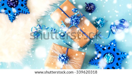 Vintage christmas gift boxes on blue background, falling snow effect, decoration concept