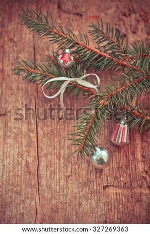 Vintage Christmas Ornament Background/ Christmas ball decorations on textured wooden background/ Composition with Brilliant Christmas decoration