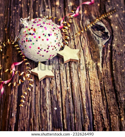 Vintage Christmas Ornament  on textured wooden background/ Composition with Brilliant Christmas Ball - stock photo