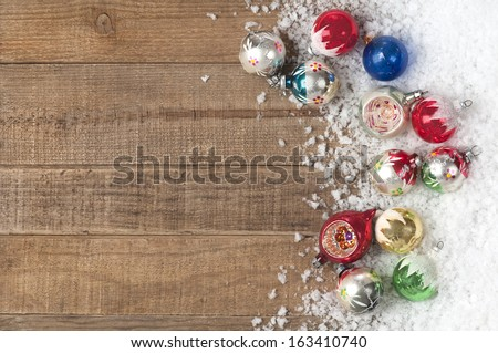 Vintage Christmas Ornaments in a Snowdrift on Wood Background with Room or Space for Copy, Text, Words,  Horizontal  - stock photo
