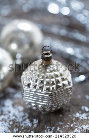 vintage christmas ornaments on a blurred silvery background - stock photo