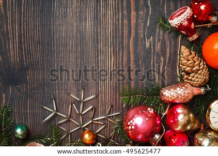 Vintage Christmas ornaments, tree branches and other decorations on the wooden background. New Year background. The concept of the winter holidays.