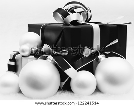 Vintage christmas present with baubles - stock photo