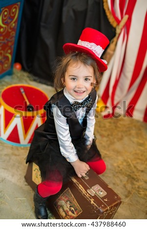 Vintage circus. Smiling girl  in front of the circus tent. - stock photo
