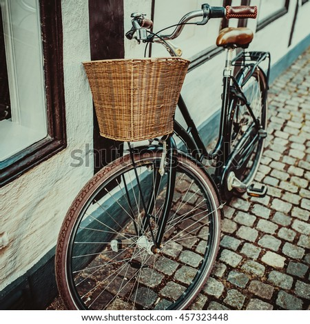 vintage city bicycle with basket in Copenhagen, Denmark