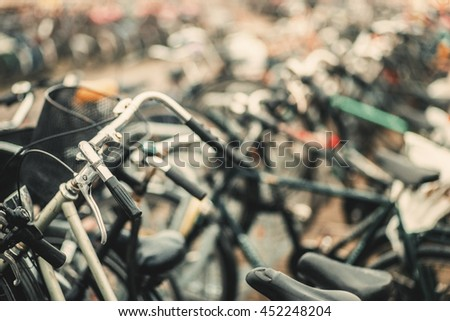 Vintage classic bicycle detail. Bike parking in modern city. Shallow focus. Light flare effect. Detail close up. Bokeh background. Soft shallow focus. Travel inspiration. Postcard concept.   - stock photo