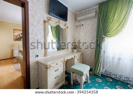 Vintage classic hotel bedroom interior. Bedroom interior design. Vintage luxurious bedroom premium double suite, dressing table with mirror. Hotel classic interior. Double room. - stock photo