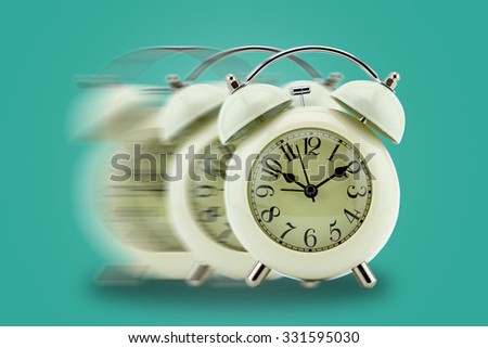 Vintage clock blurred - conceptual image of time running or passing away, business concept - stock photo