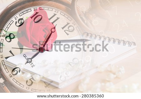 vintage clock fade on red rose, diary and number on calendar background. Memory concept.