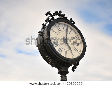 Vintage clock in the sky - stock photo