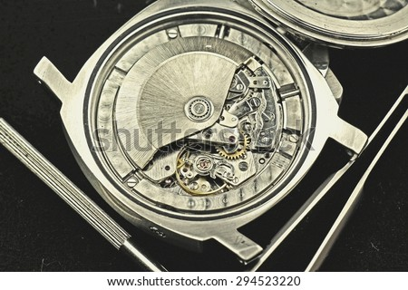 Vintage Clock mechanism with gears, watch movement, Detail of clock parts for restoration. - stock photo