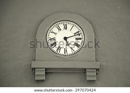 Vintage clock on an old stucco wall. Tower clock. Wall Clock. - stock photo