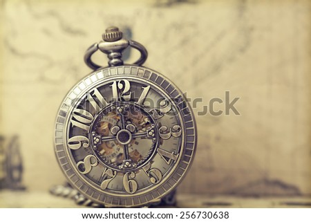 Vintage clock on antique map. Retro still life - stock photo