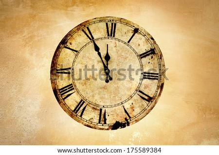 Vintage clock on rough wall. - stock photo