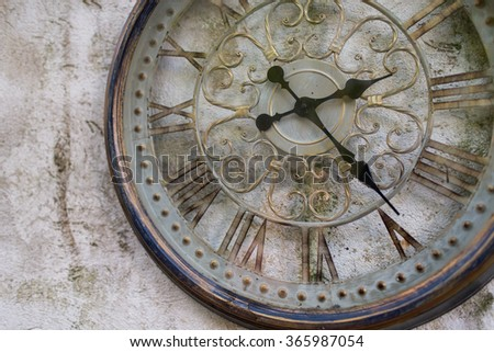 Vintage clock on the wall - stock photo