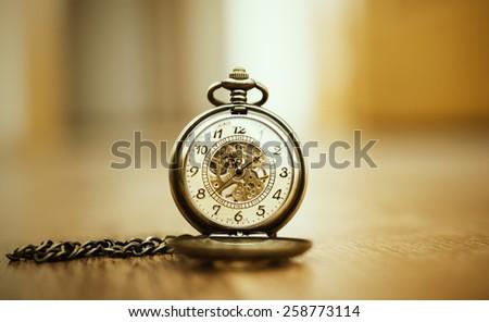 vintage clock on wooden floor - stock photo
