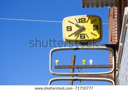 Vintage Clock Street Sign - stock photo