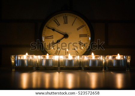 vintage clock with candles on the front night time
