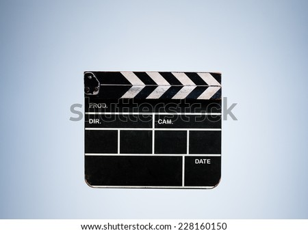Vintage Closed Clapperboard Cinema isolated on Blue Studio Background with Text Space - stock photo