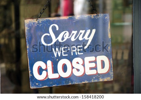 Vintage closed sign in shop window - stock photo