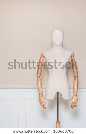 vintage cloth dummy in cozy room - stock photo