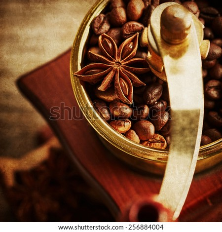 Vintage coffee grinder on wooden background - stock photo