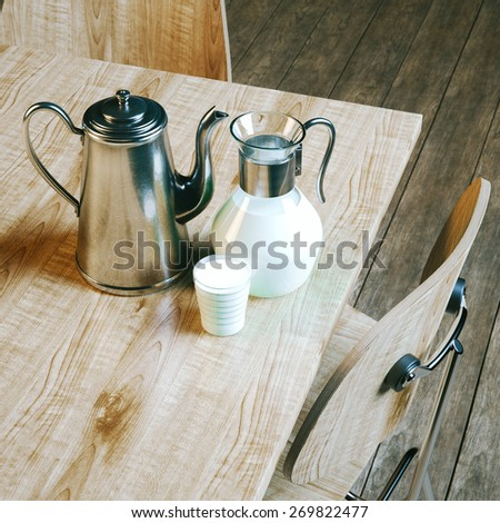 Vintage coffee kettle and jug with glass full of milk. Picture of breakfast on wooden table in modern kitchen with wooden parquet flooring