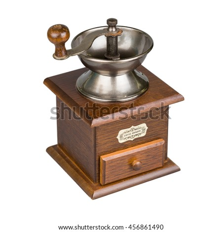 Vintage coffee mill isolated on white. Kitchen appliance. - stock photo