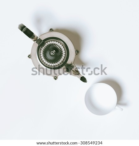 Vintage coffee pot and empty cup top view - stock photo