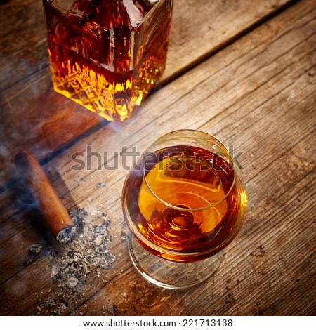 Vintage Cognac and cigar on wooden background - stock photo