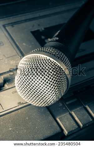 Vintage color filtered of radio sound equipment and microphone.  - stock photo