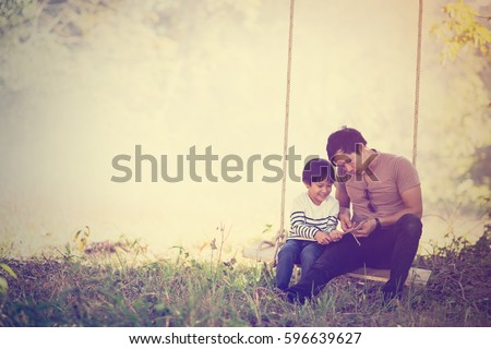 Vintage color photo happy joyful father having fun and son, family, travel, father's day - concept. Sunlight